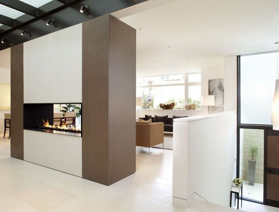 :: FIREPLACES :: simple open 2 way fireplace insert featured in Russian Hill Residence by John Maniscalco Architecture #fireplaces