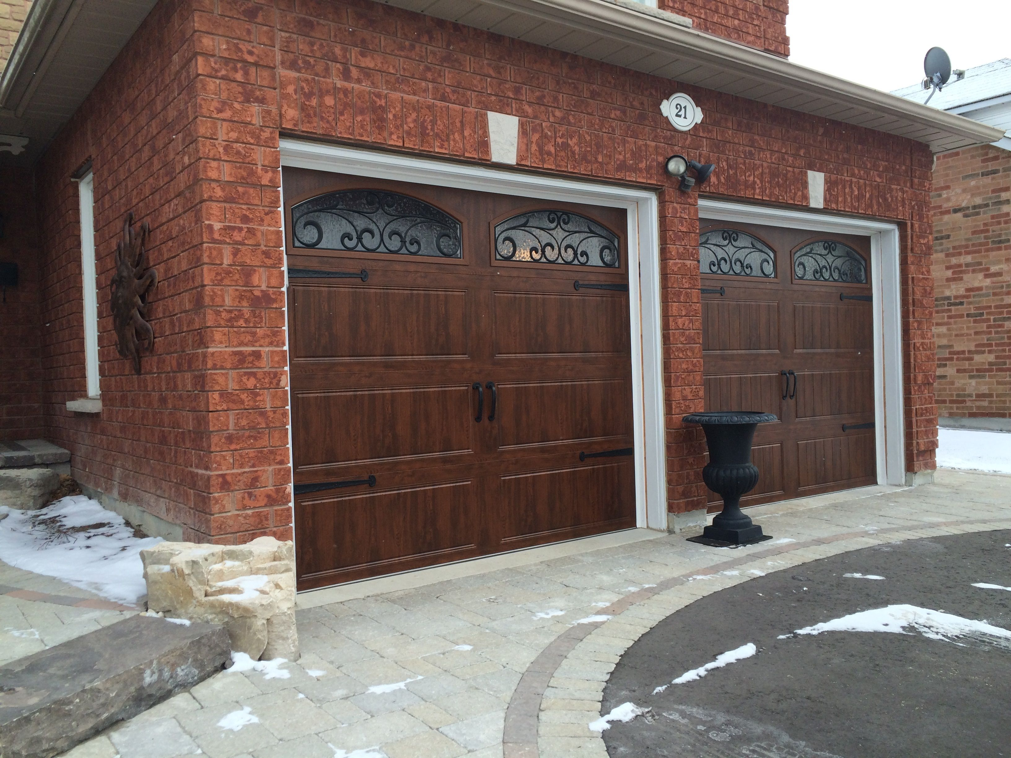 8x7 clopay walnut finish carriage doors with arched for Garage door finishes