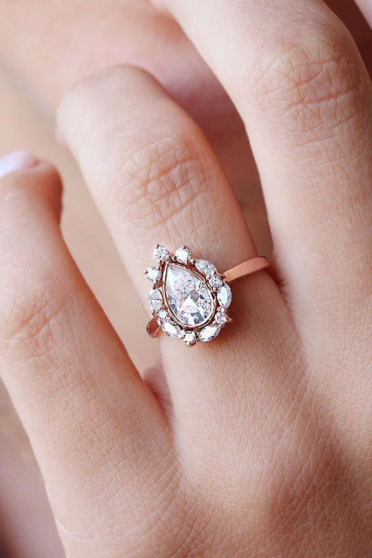 Unique pear shaped moissanite diamond halo engagement ring