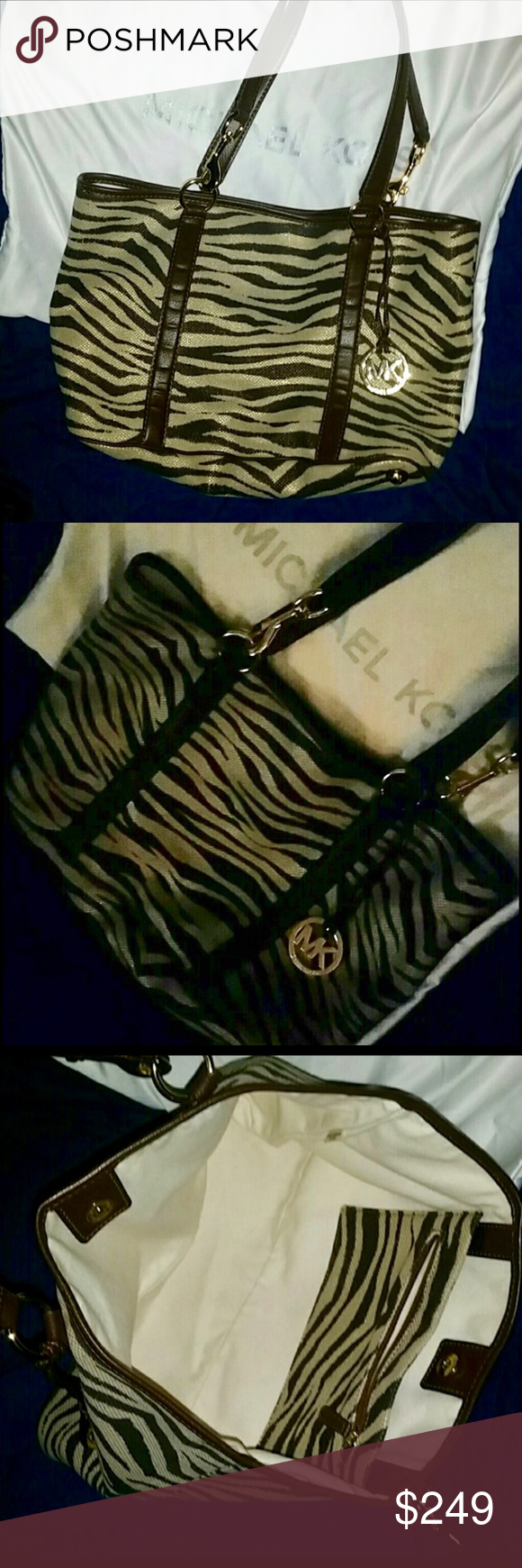 Huge Never Carried Michael Kors Tiger Jet Tote Gorgeous and exotic. Glorious Tiger signature MK Tote Bag with included pouchette and dust cover.  She is such a beauty. Show your fierce side with this classic bag with a twist.  Great gift idea. #MK Tiger print bag MICHAEL Michael Kors Bags Shoulder Bags