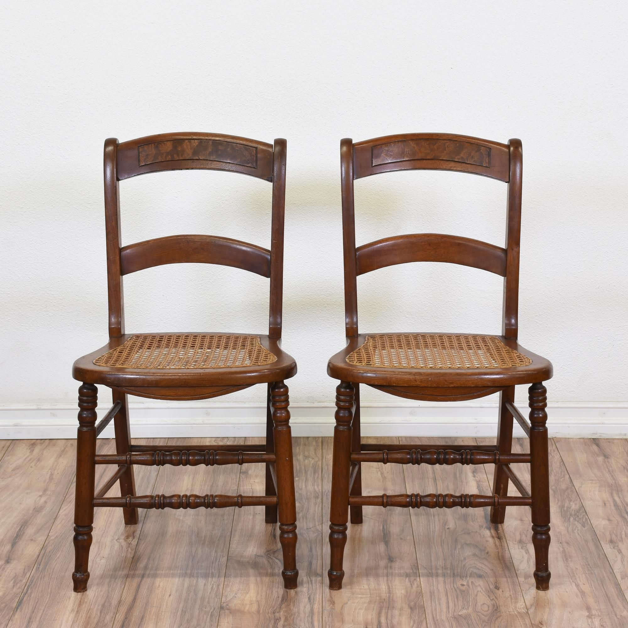 These cane seat dining chairs are featured in a solid wood with a