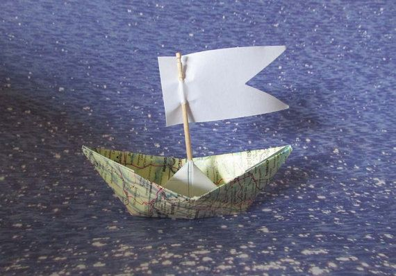 Photo of Paper boat origami decoration sail boats maps atlas nautical ocean beach summer holidays