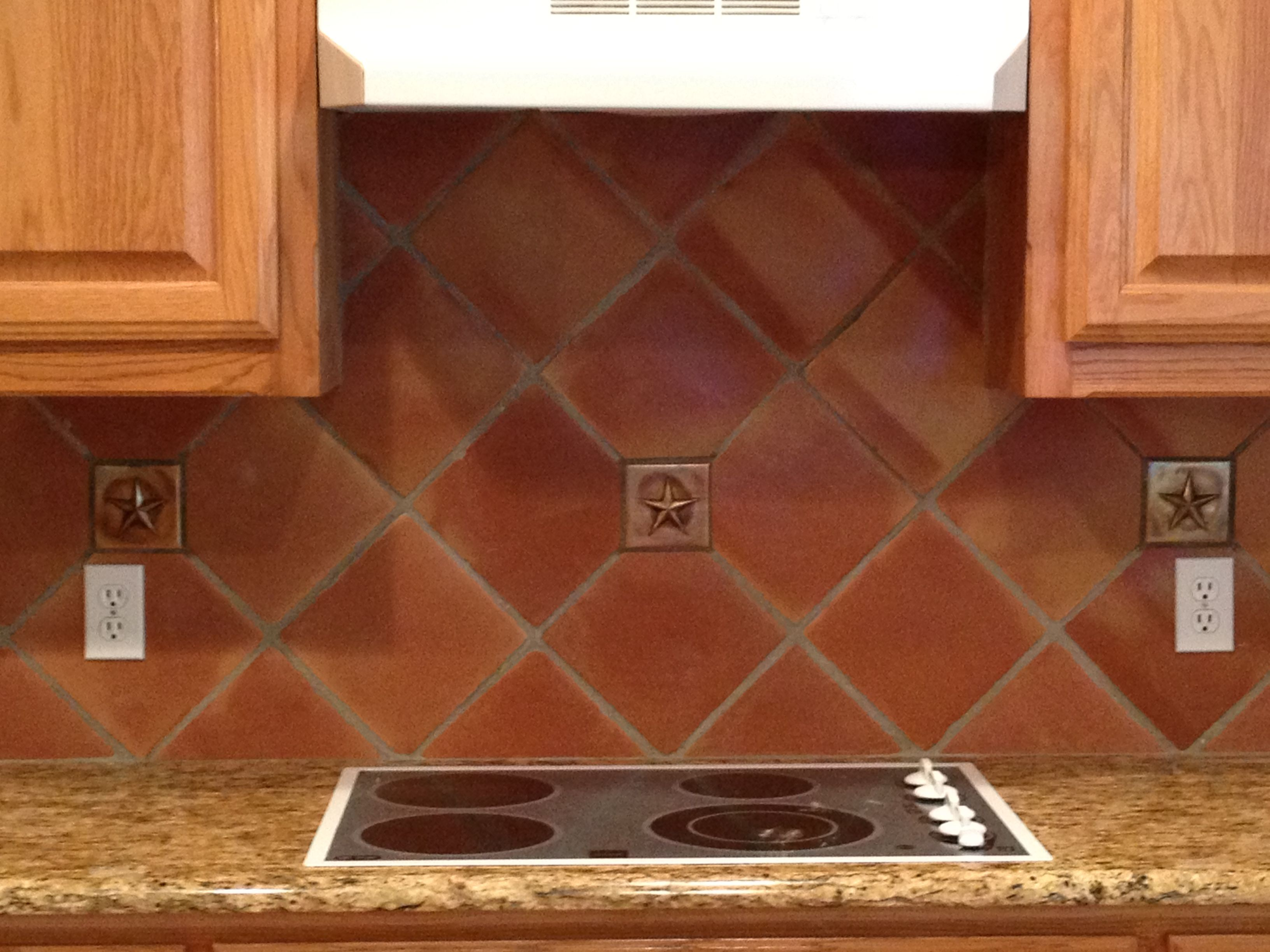 8 inch Saltillo Terra Cotta tile used in a classic kitchen back ...