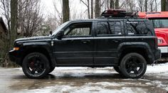 Lifted Jeep Patriot 235 65r17 Cooper Discoverer At3 Tires 2 125