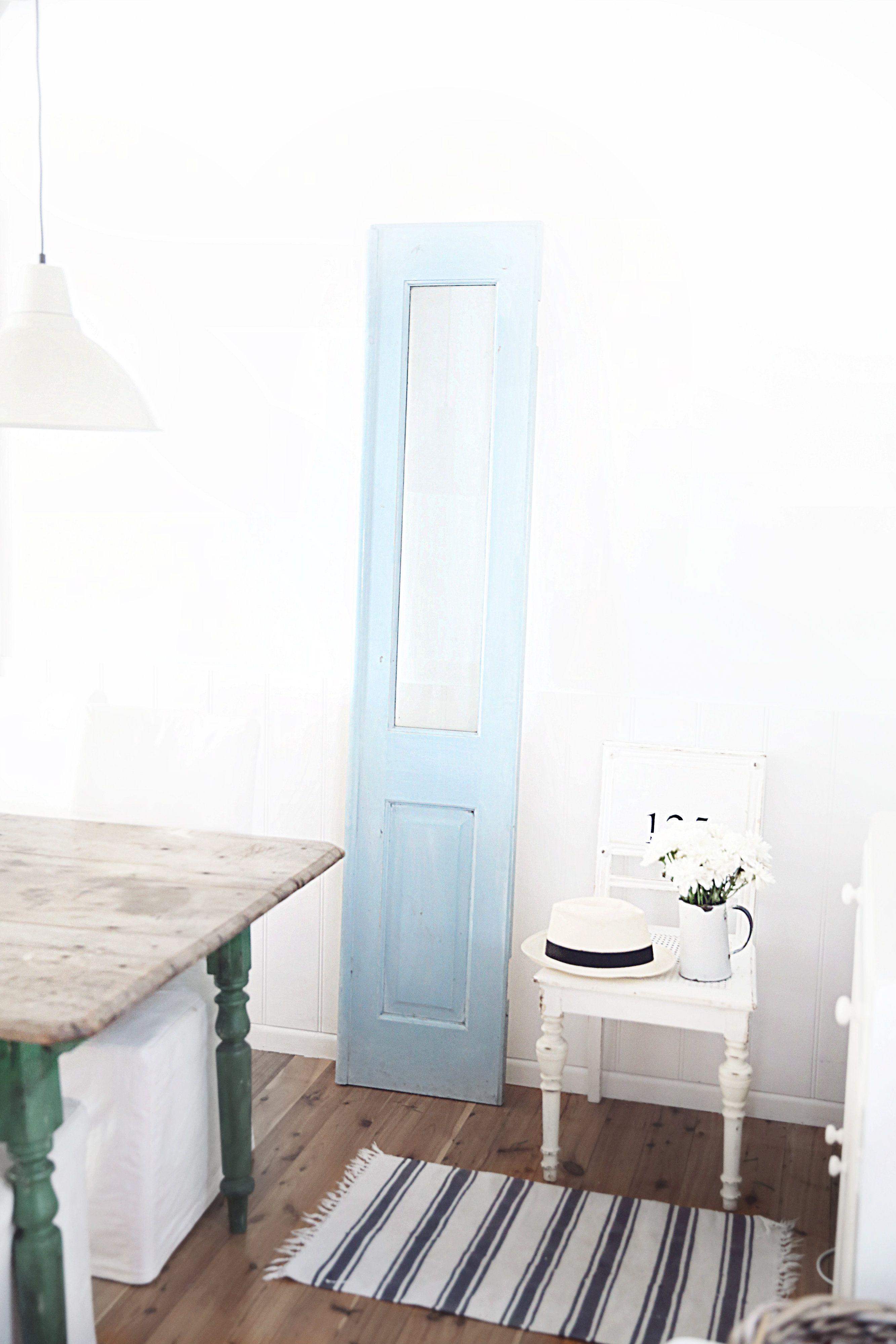 Beautiful kitchen cabinet color. old blue shutter door abeachcottage.com