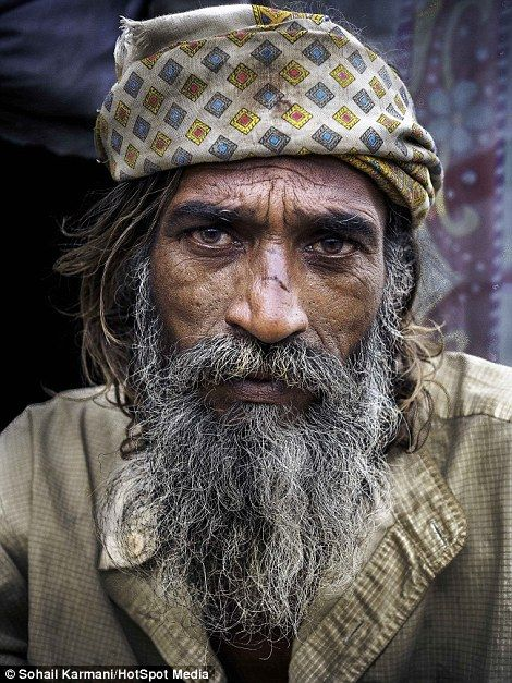 A mystic and an elderly man, pictured by photographer and writing professor Sohail Karmani, in a slum in the Pakistani city of Sahiwal