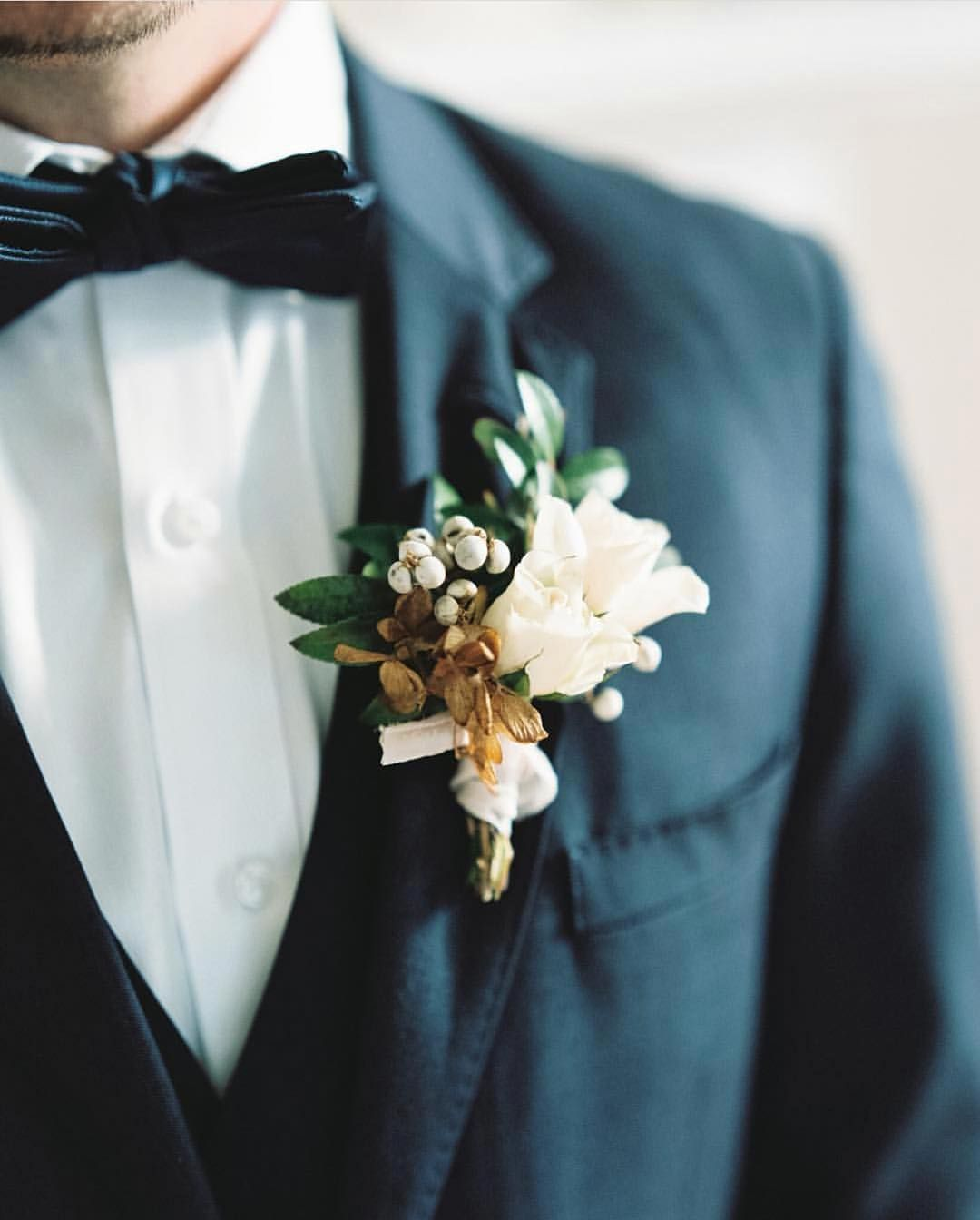 A perfectly placed boutonniere on a classic tux is one of my ...