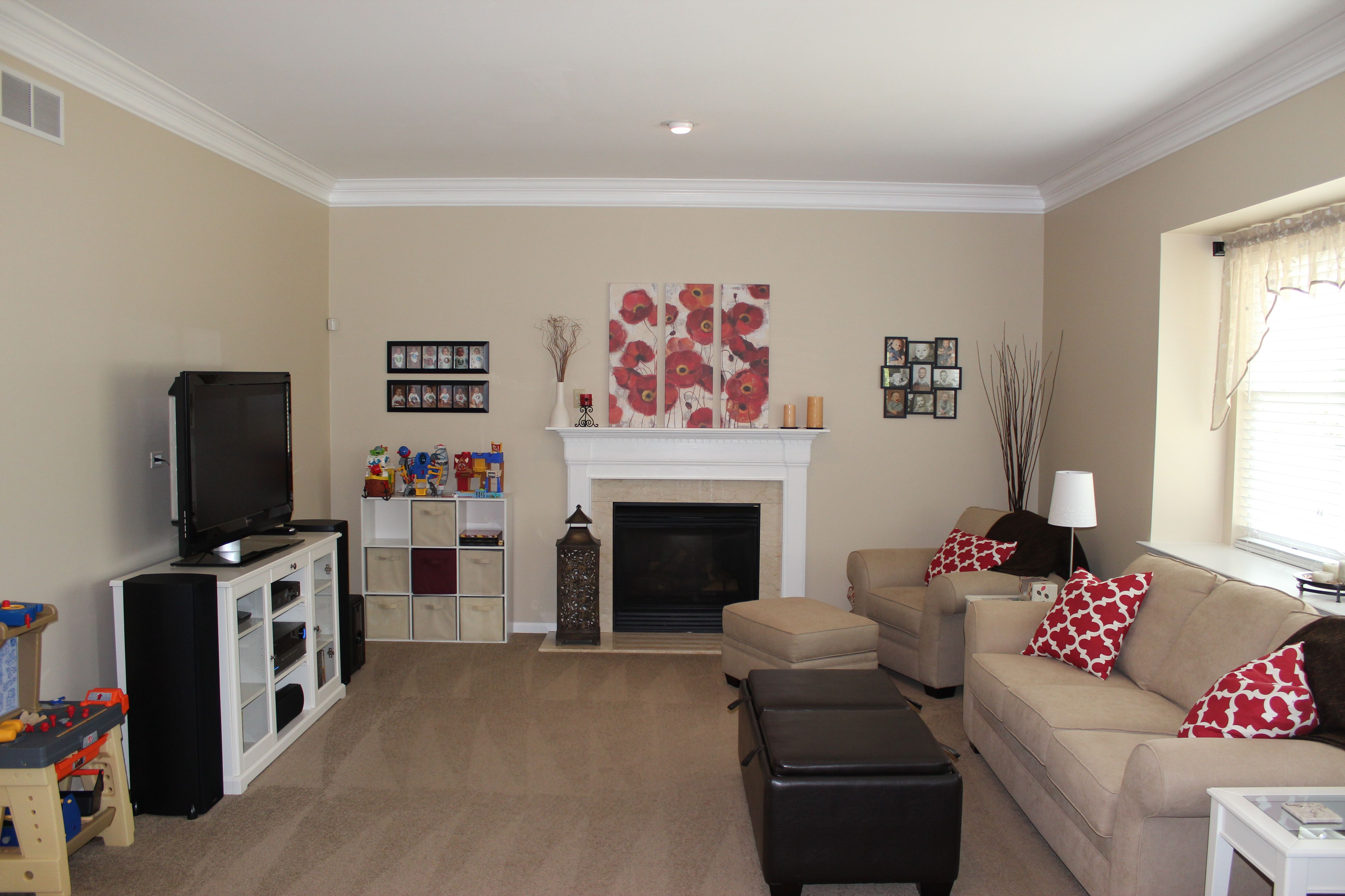 My Own Family Room Sherwin Williams Softer Tan I Love It With The Red Accents Living Room Colors Paint Colors For Living Room Tan Living Room