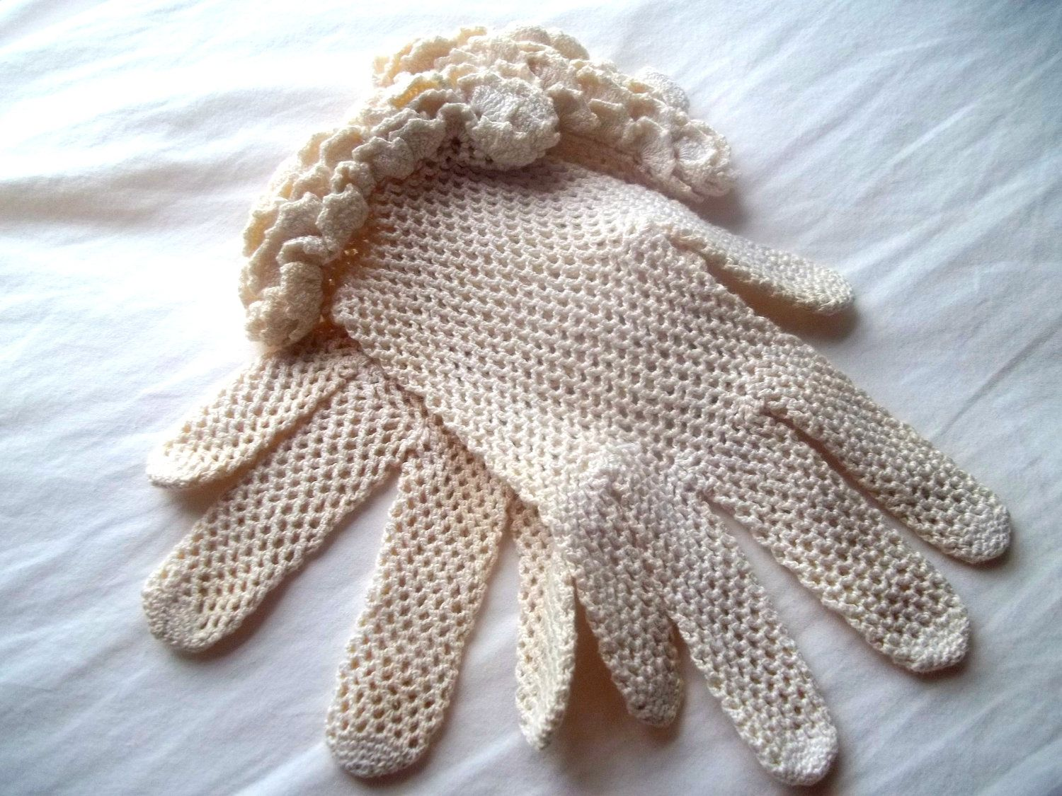 Vintage Crocheted Lace Women's Gloves Cream fishnet with lace wrist ruffle. $20.00, via Etsy.
