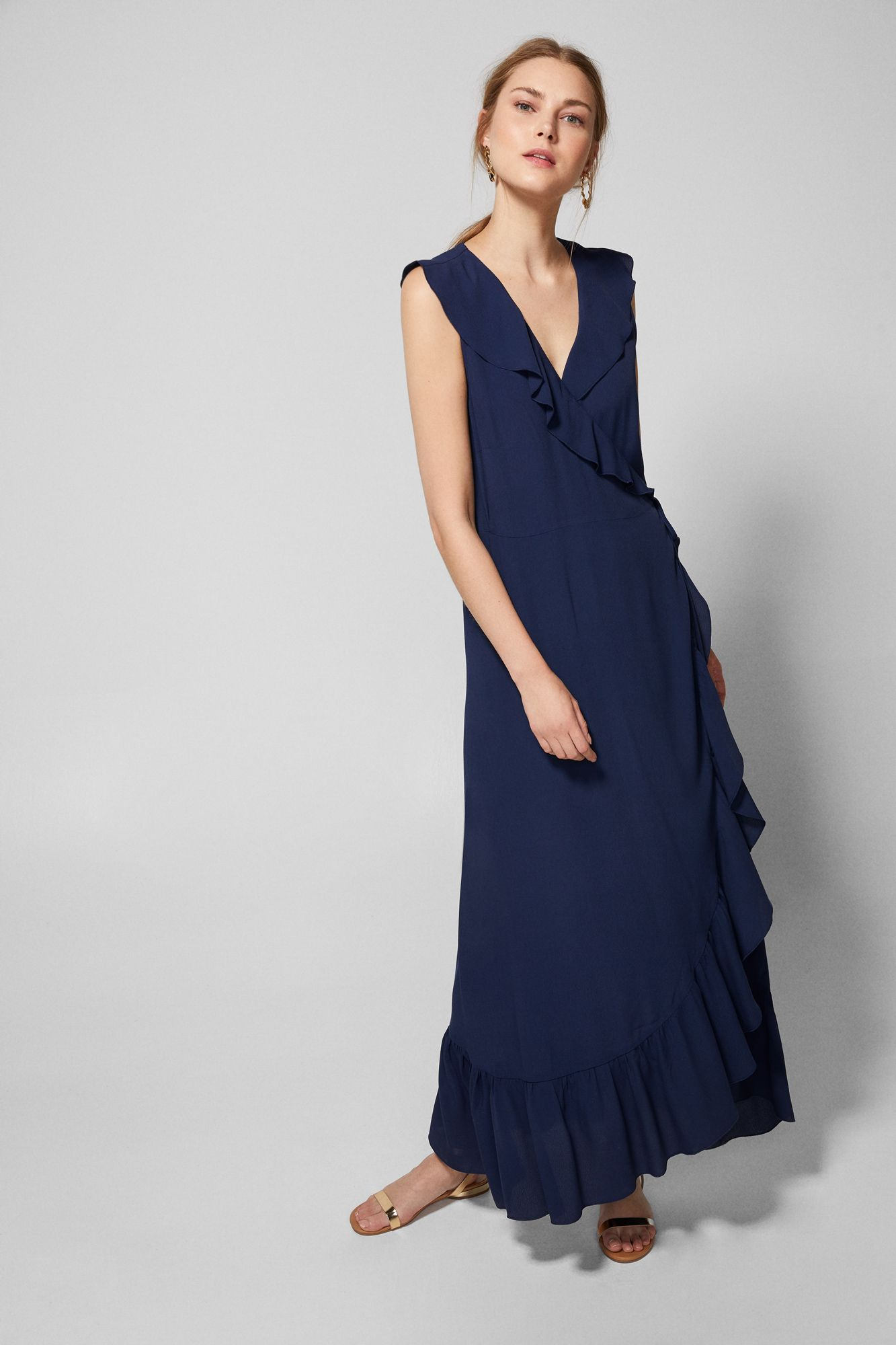 Long dress with a wrap neckline and ruffle detail on the neckline