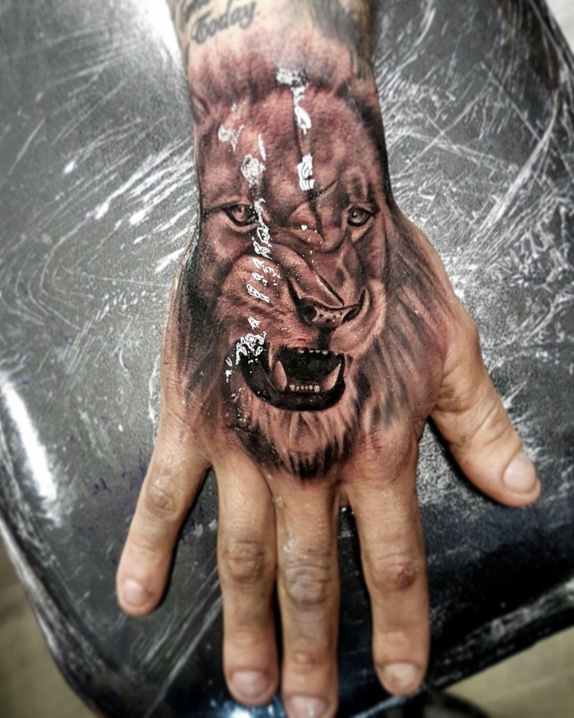 Lion hand tattoo Lion hand tattoo, Hand tattoos for guys