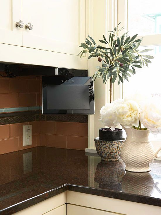 in between spaces between upper cabinets and the countertop is the perfect space for a small television screen that doesnt obstruct the counter - Small Tv For Kitchen