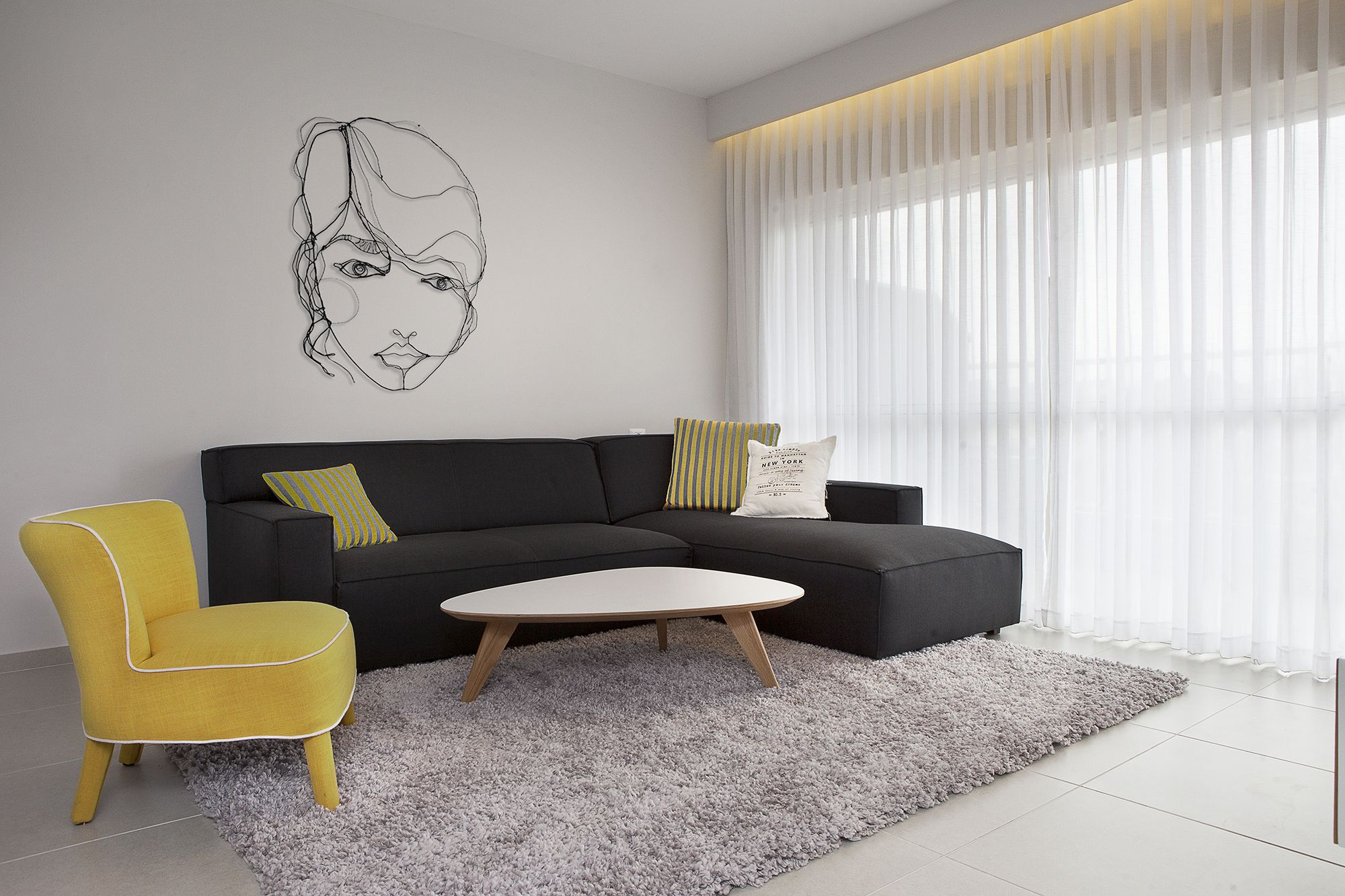 Modern Living Room With Gray Sofa And Yellow Armchair Designed By Dana Shaked Interior Decorating Living Room Simple Living Room Designs Minimalist Design Sofa