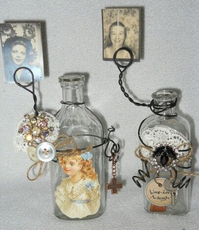 Repurposed bottles into photo/place card holders.