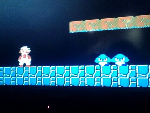 Playing the original Super Mario Bros.