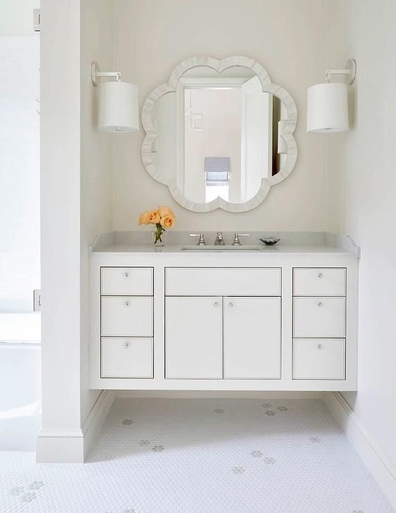 A Chic Bathroom Nook Is Filled With White Capiz Mirror Made Goods Fiona Illuminated By Barbara Barry French Cuff Sconces Placed Over