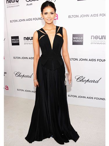 Nina Dobrev  The Vampire Diaries beauty looks divine in this plunging V-neck, skillfully cut-out J. Mendel gown.