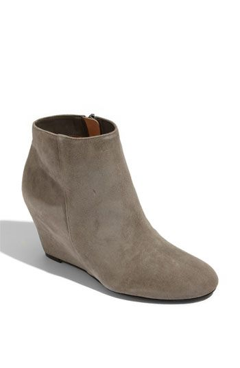 c88d7e685769 I need these booties! Via Spiga  Harrison  Wedge Bootie Chic minimalism  defines a suede bootie lifted by a wrapped wedge heel. Side zip closure.