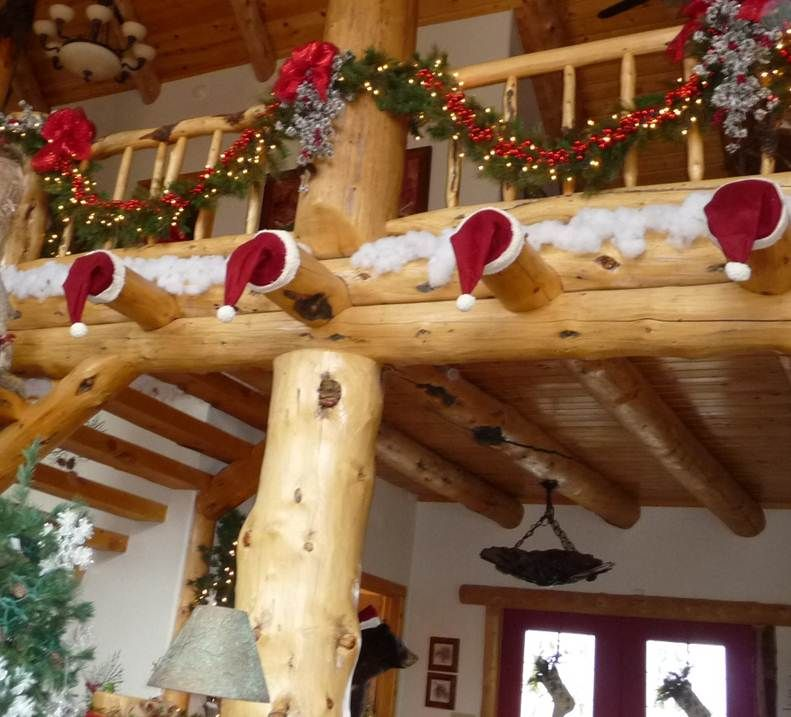 What to do with the logs in a log cabin at Christmas time. Pass the hat please