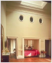 The three portholes above his alcove bed ventilate the   closet where Jefferson stored his off-season clothes. When he awoke, as soon as he could see the clock at the bed's foot, he stepped under his lofty dressing room's louvred skylight to be bathed in light. Thomas Jefferson's Monticello