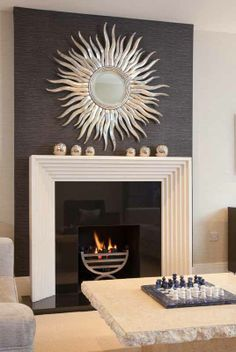 Black Feature Chimney Breast With Sunburst Mirror And Cream Fireplace