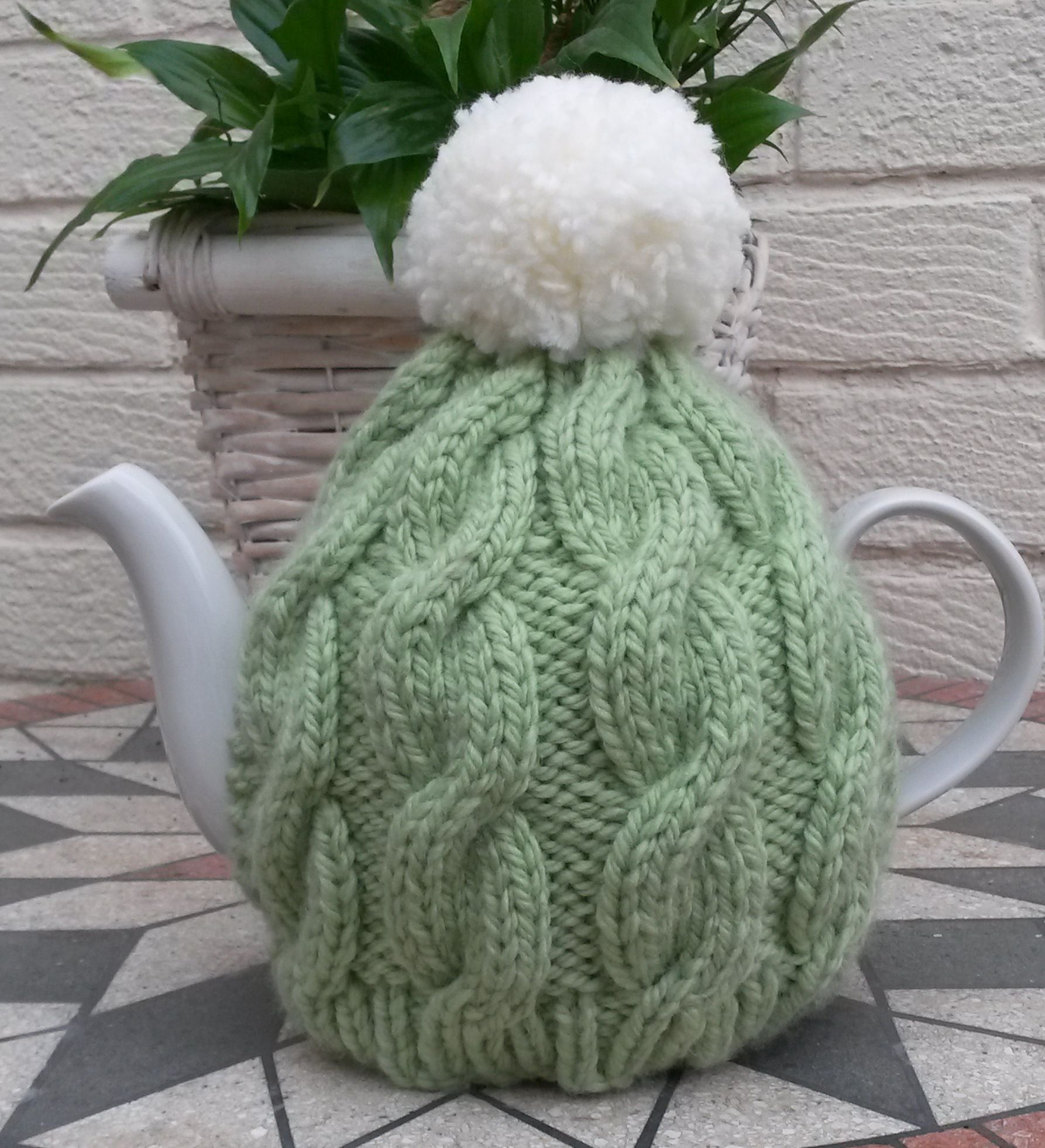 Chunky knit cable tea cozy in sage green with cream pompom ...