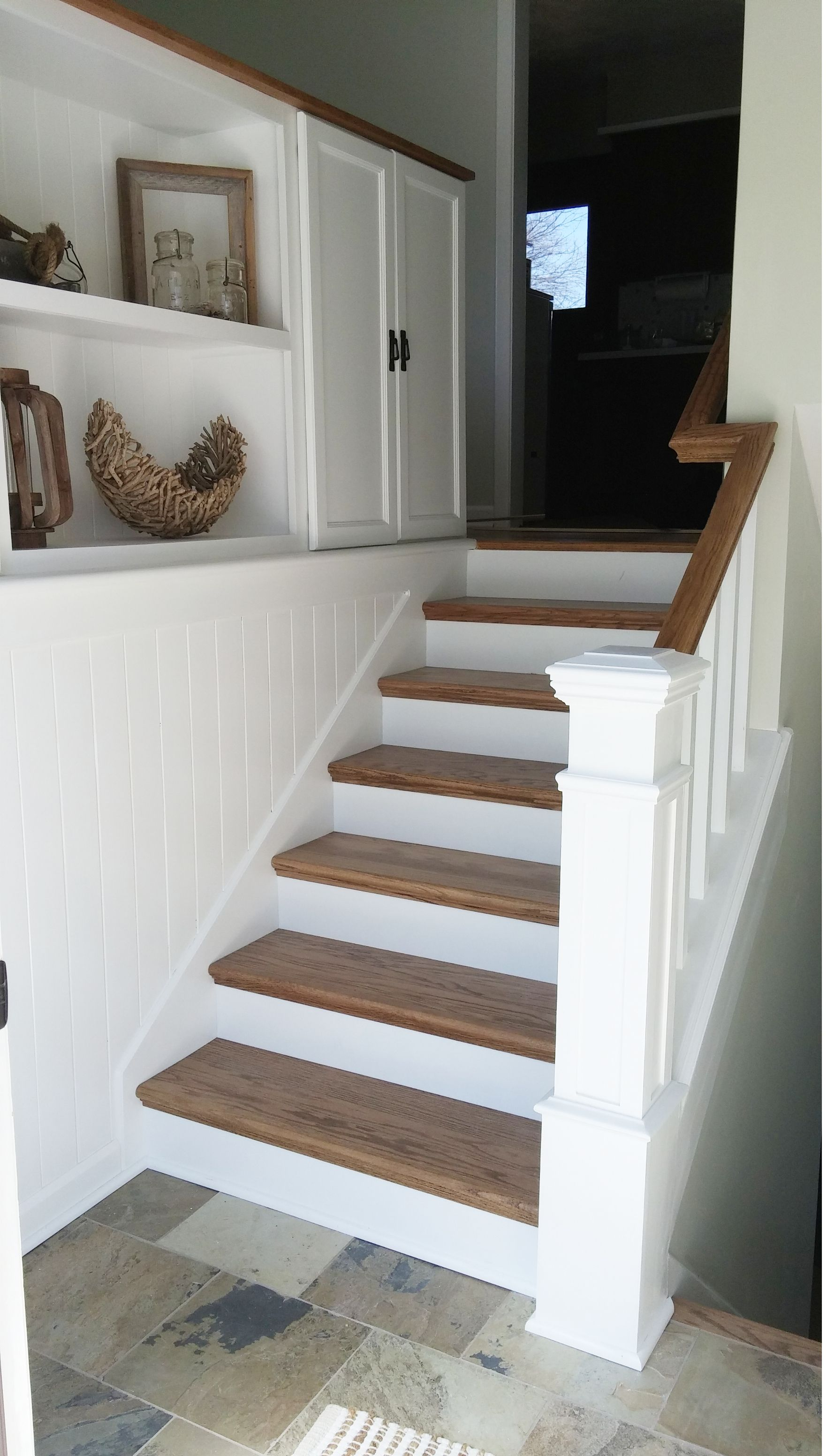 Diy Split Entry Remodel Added Storage Planking To Tie The Wall And Cabinets Together Changed Railings Split Entry Remodel Split Foyer Raised Ranch Remodel