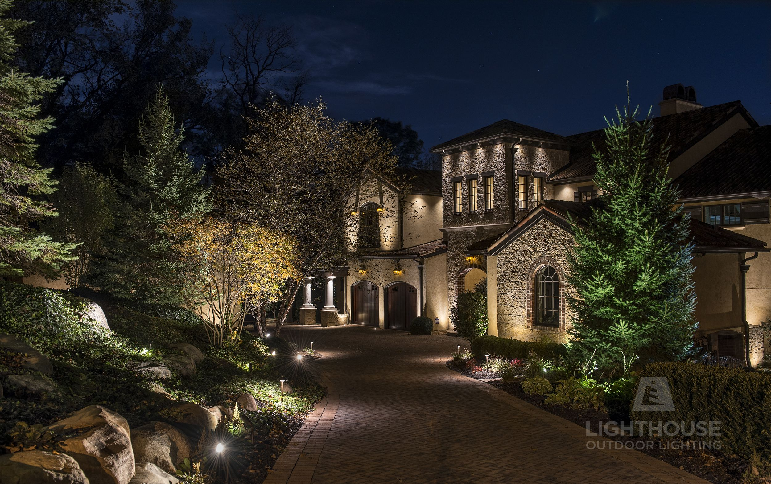 Spanish Mediterranean Home Lit By Lighthouse Outdoor Lighting Of Indianapolis Winner Of The 201 Outdoor Lighting Landscape Lighting Landscape Lighting Design