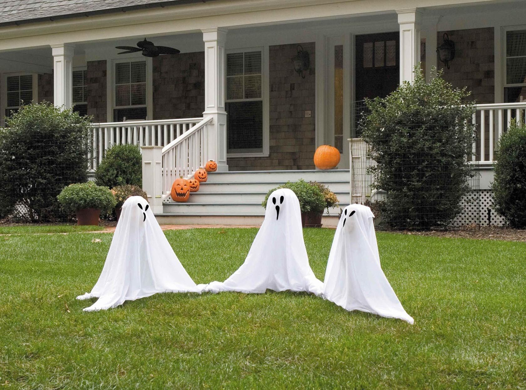 Ghostly Group Outdoor Halloween Prop Decoration 3 Per Set is part of Front lawn Decorations - Your yard can be the scene of the haunting with this ghostly group set  This lawn decoration set includes 3 lawn ghosts with easytoassemble stakes for quick setup  The ghost is composed of a foam head, with a white cloth attached over the top of the head  A black ghost face is printed on the front  Just plant them in your yard and watch the terror unfold!