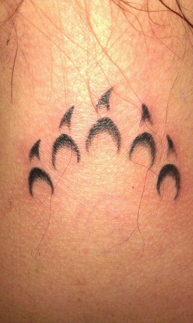 Bear paw tattoos on boobs