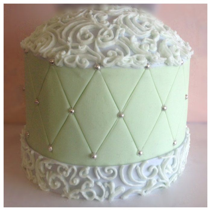 Girl's First Communion Cake---covered in white chocolate ganache finished in fondant piped colored royal icing sugar pearls.