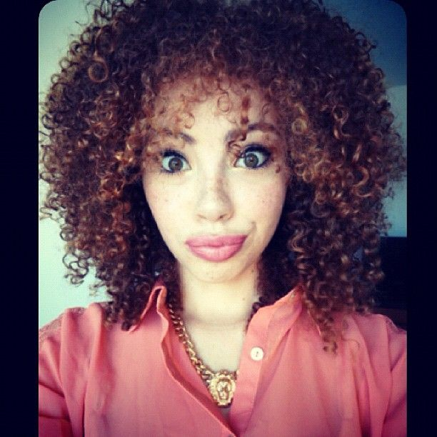 Shoulder Length Dark Curly Hairstyle With Red Highlights Curly