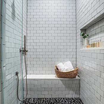 white shower wall tiles with black grid shower floor tiles