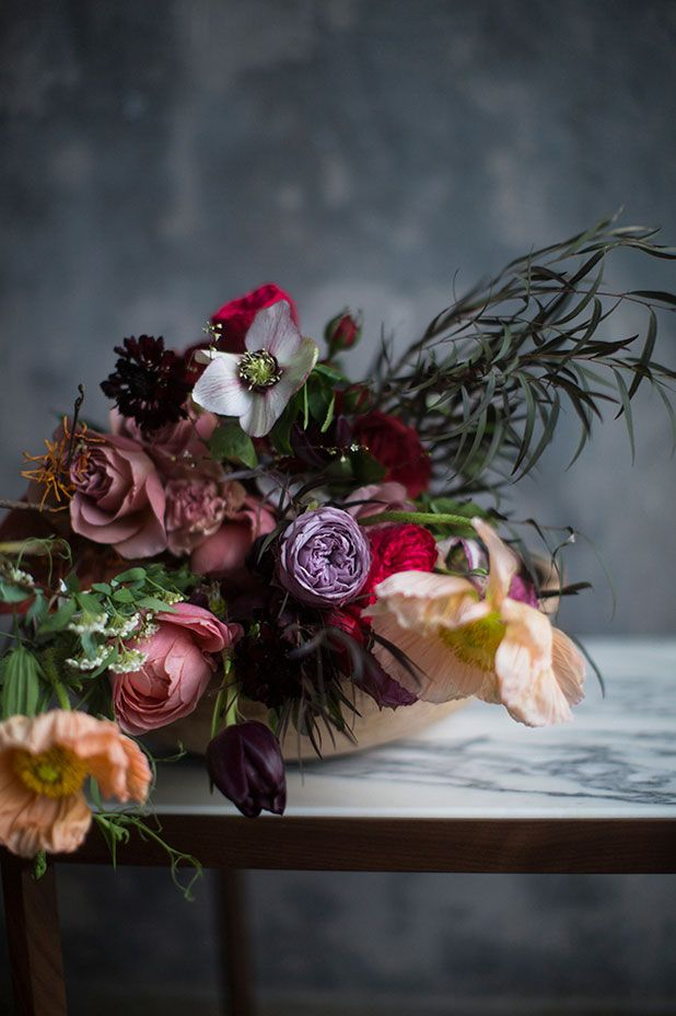 Black, peach, purple, and red bouquet of roses, poppies, tulips...