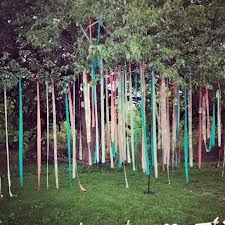 Outdoor tree wedding decorations wedding ideas pinterest wedding decoration ribbon garlands from tree outdoor junglespirit Images
