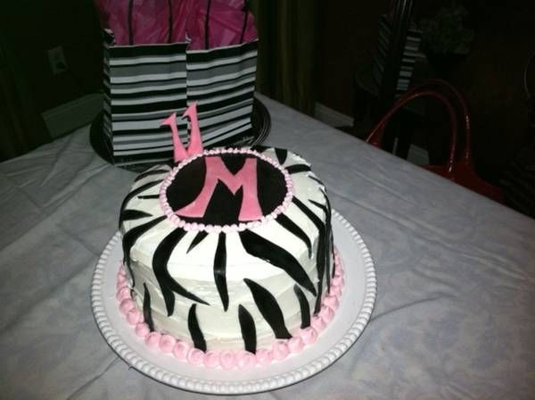 My tween's is now 11 and this was her birthday cake.  Zebra theme was created with fondant from Michaels Craft.