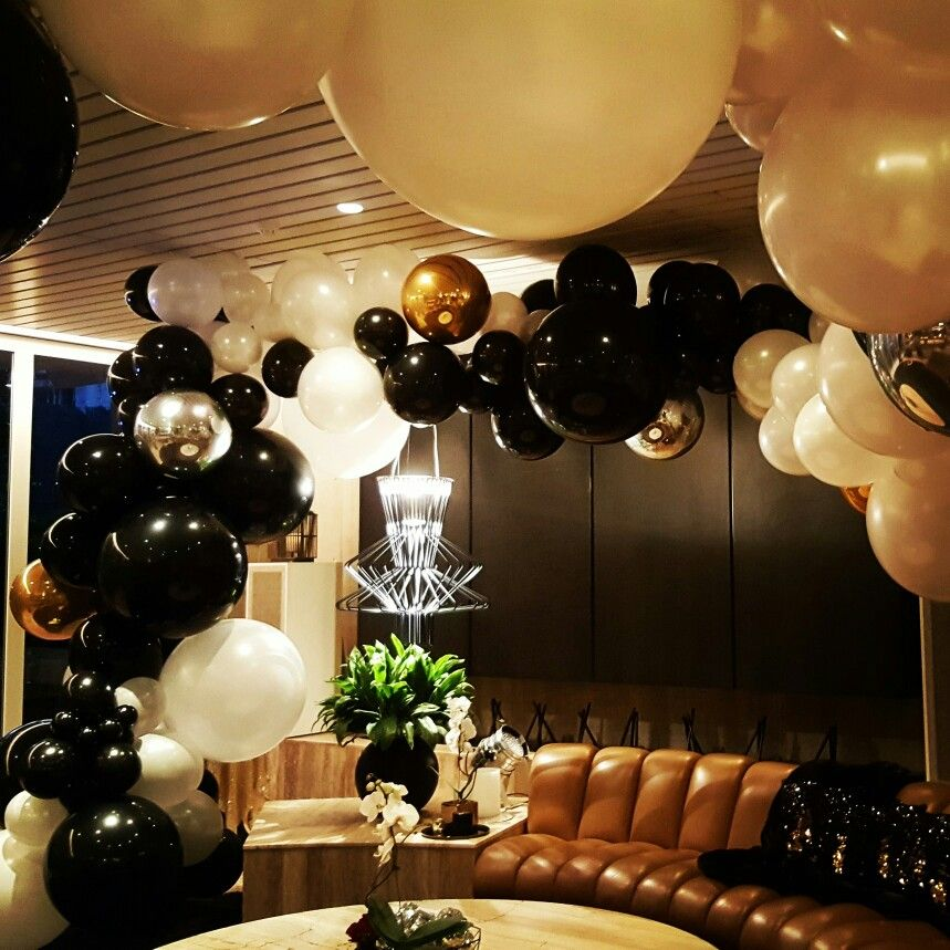 Black and white with silver gold orbz balloons