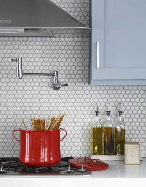 white hex tile backsplash with light gray grout