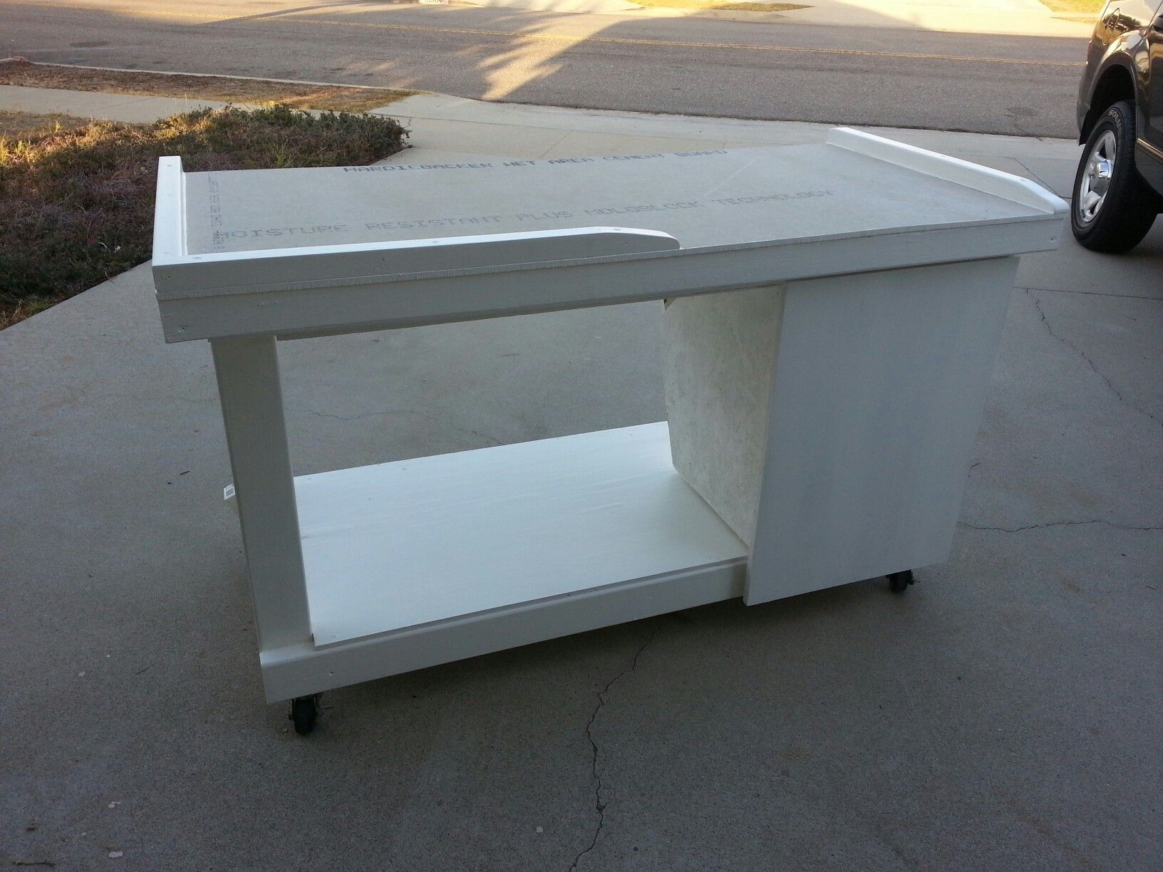 2x4 construction, a sheet of plywood, 3x5x1/2 Hardie cement board ...