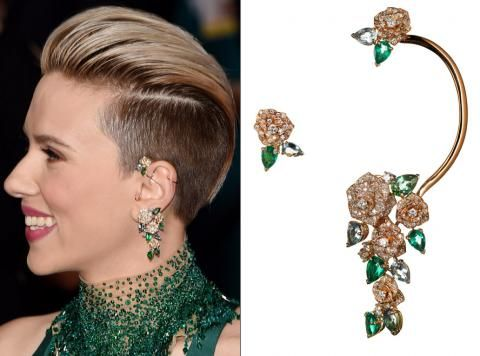 Scarlett Johansson wears Piaget's Mediterranean ear cuff to perfection. The floral design featured pear-shape emeralds, aquamarines, and tourmalines accented with 278 diamonds.