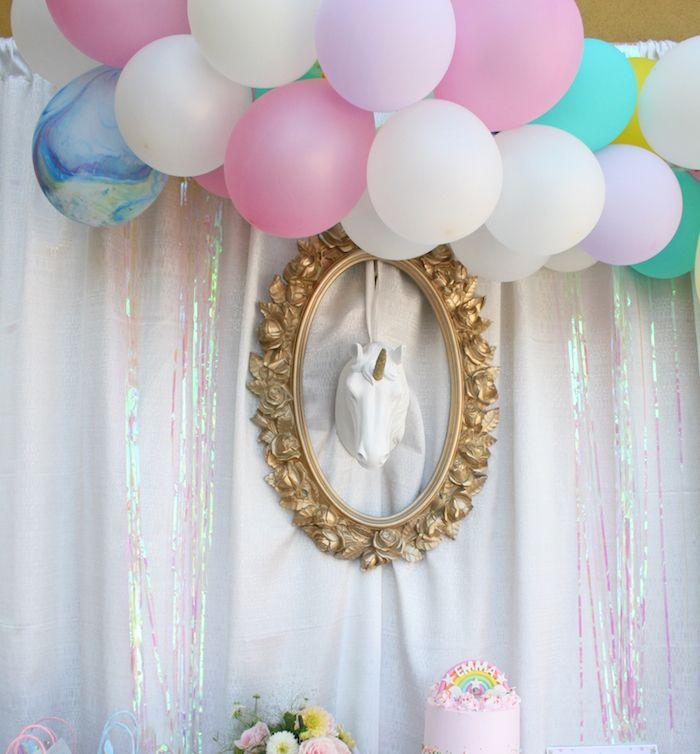 Unicorn head balloon backdrop from a Magical Unicorn Birthday