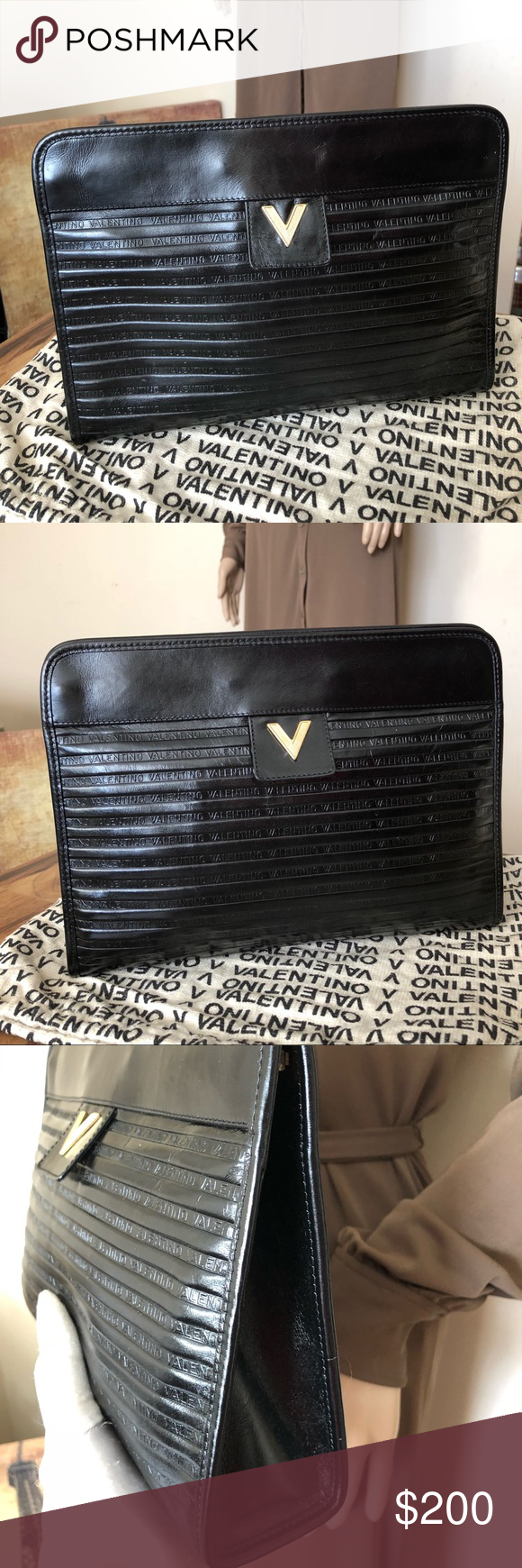 54c4363d097 Mario Valentino Black Logo Embossed Vintage Clutch This vintage black  leather clutch is designed with the