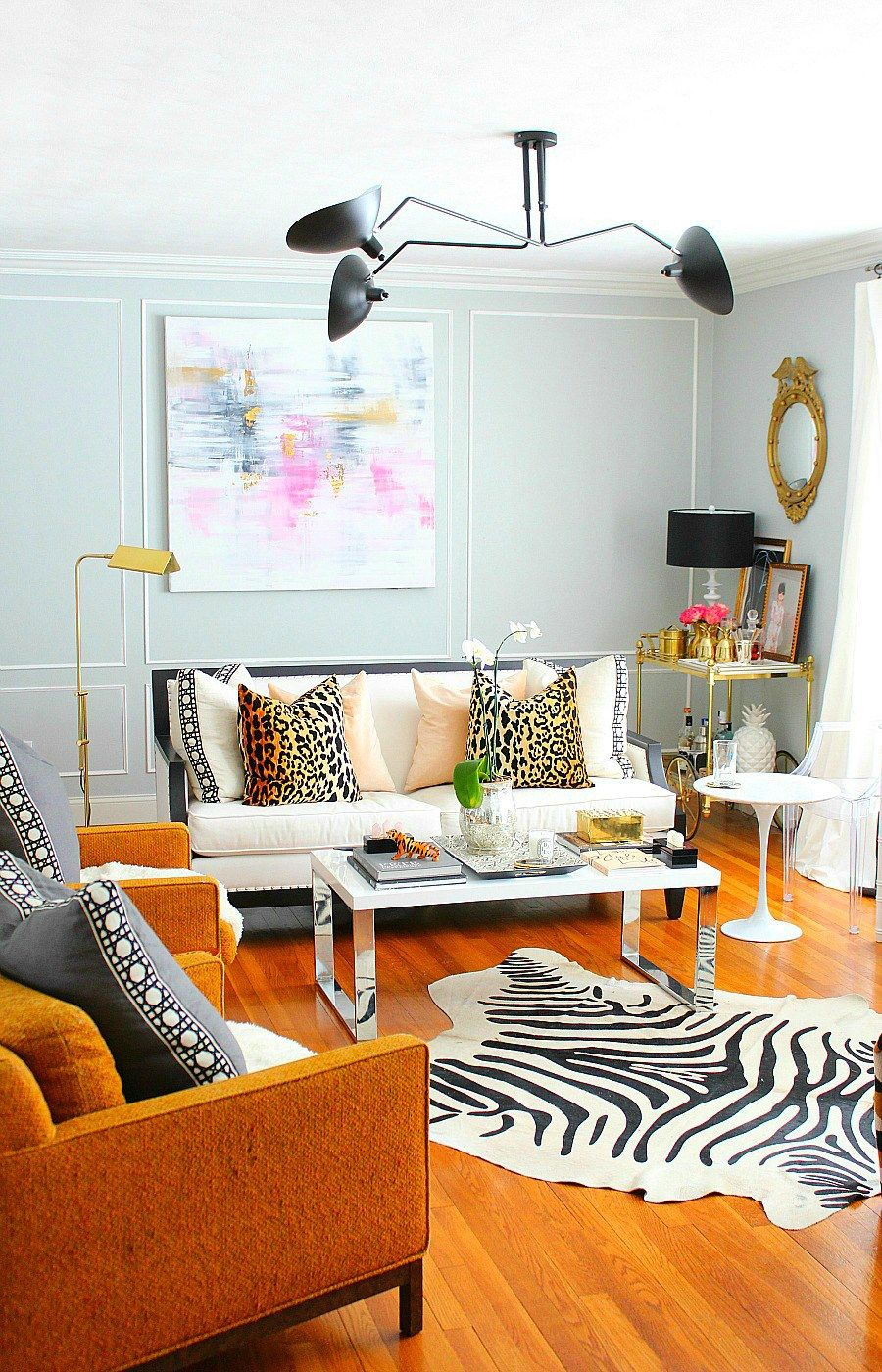 Parisian modern inspired living room makeover with Serge Mouille inspired lighting and wall mouldings,