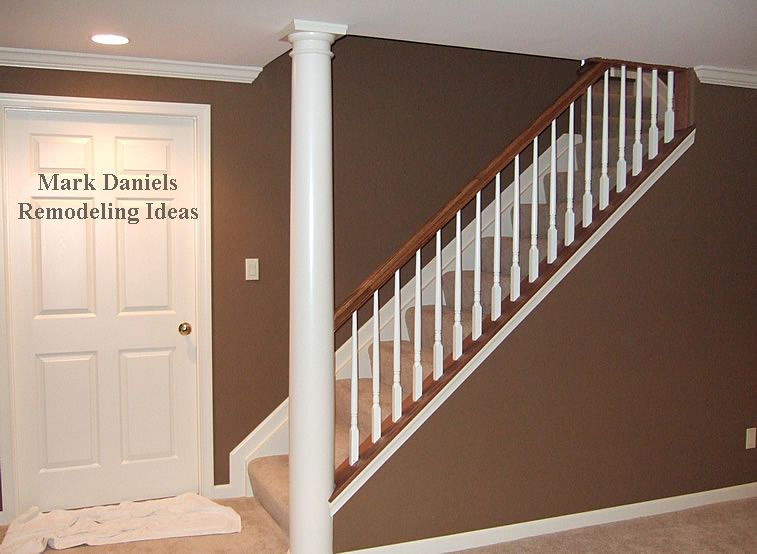 Finished Basement Incorporating Support Beams Stairs One