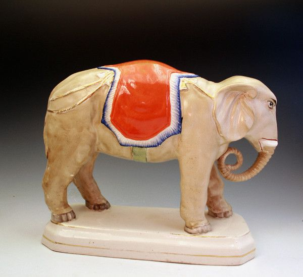 STAFFORDSHIRE FIGURE OF A STANDING ELEPHANT, VICTORIAN PERIOD