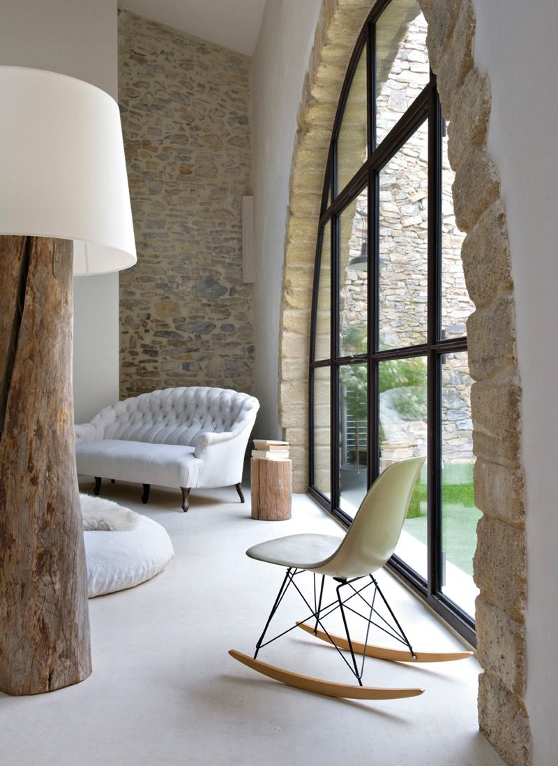 Modern window ideas  stone arch and stonewall featured in this interior environment