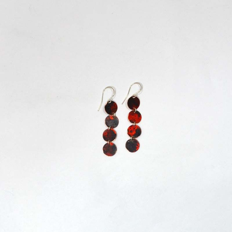 Red Patina Earrings, $30. Add a little edge and excitement to your outfit with these red patina disc earrings!  4 copper discs with red patina, handcrafted by a North Carolina artist.