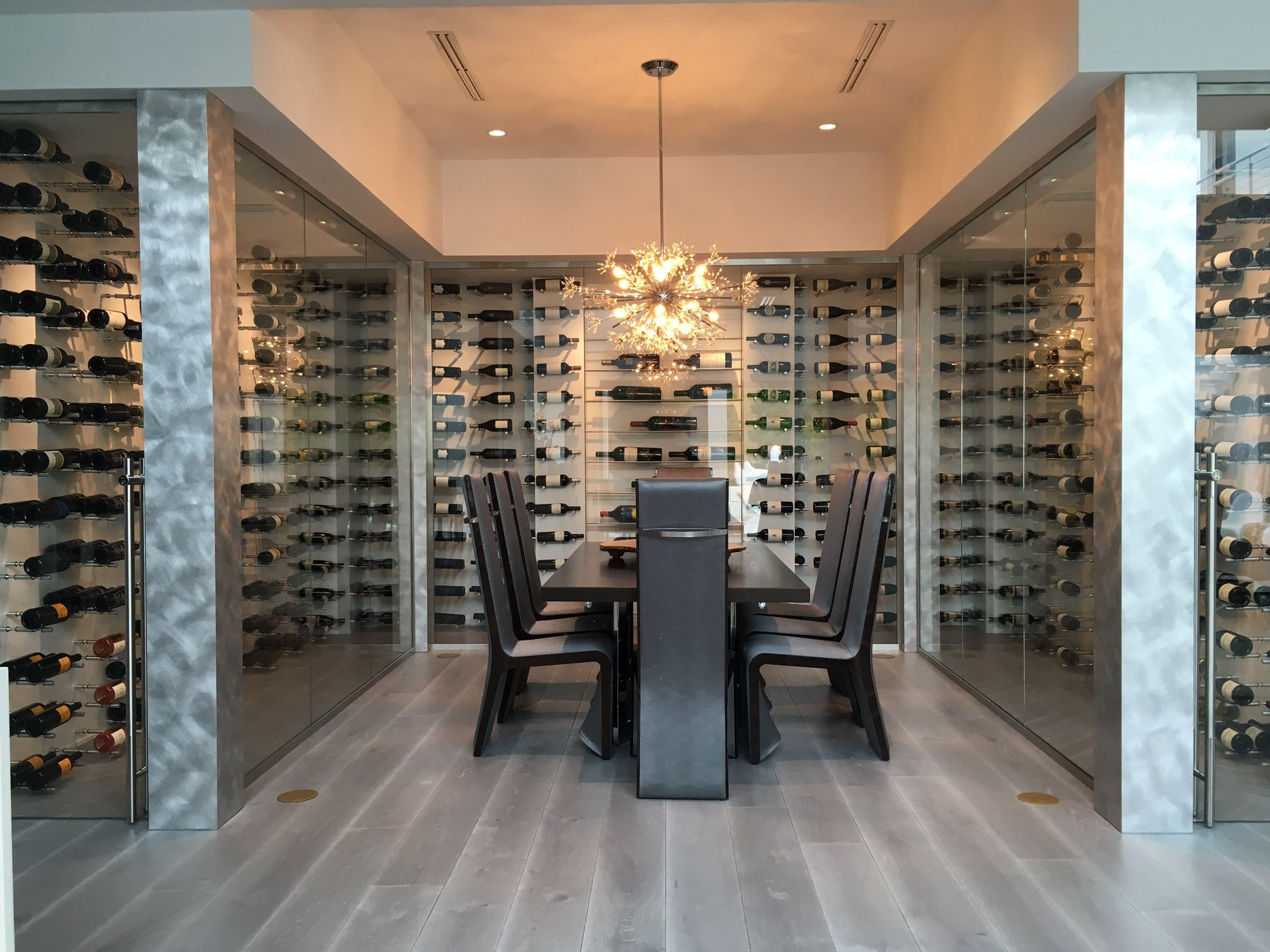 U Shaped Glass Wall Wine Cellar In Naples Florida Holds 932 Bottles Contemporary Racking Climate Con Contemporary Wine Cellar Wine Cellar Modern Wine Room