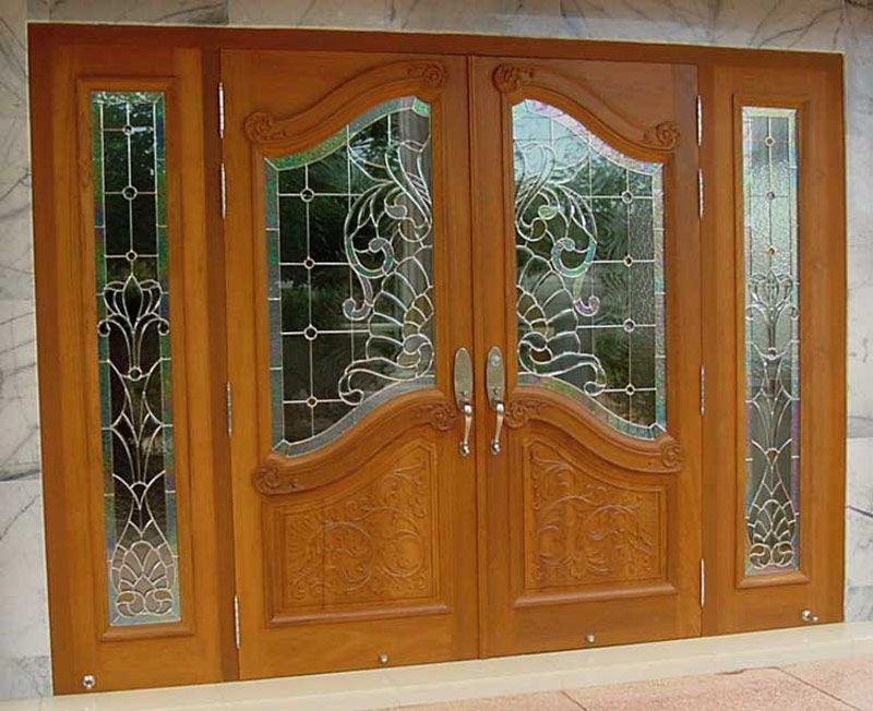 Grand front door entrance double front door bifold for Double wood doors with glass