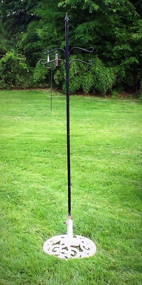 Used An Old Umbrella Stand As A Base For My Shepherd S Hook Now I Can Easily Move Bird Feeder Wherever And Whenever Want